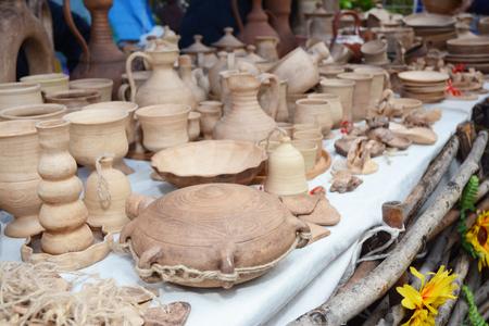Traditional ceramic jugs on decorative towel. Showcase of handmade ceramic pottery.