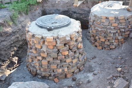 Building construction septic tanks from bricks
