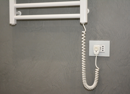 Electric Towel Rails with Thermostat. Electric Towel Rails & Bathroom Radiator switched on.