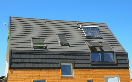 Modern house construction roof with  solar water heaters.