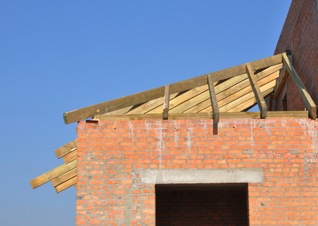 Roofing construction with wooden rafters, eaves and timber.