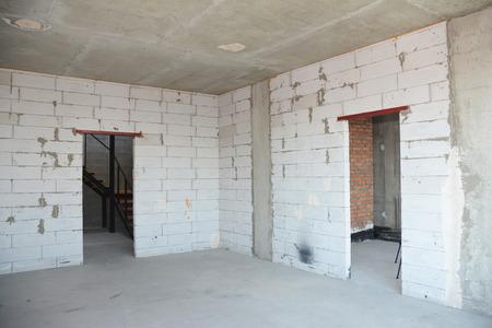 Empty room interior build with plastering wall, drywalls, stucco, metal door lintel. Stock Photo