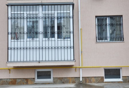 Metal grid for window and balcony protection. Houseflat balcony window with iron security bars. Stok Fotoğraf