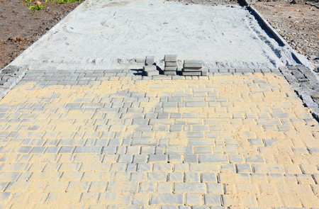 Installing garden patio from pavers. Paving.
