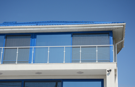 Modern blue house with glass balcony. Contemporary house disign. Stock Photo