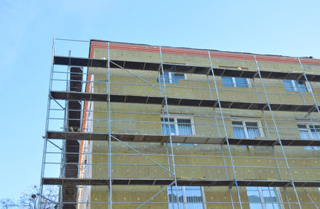 Building wall renovation with rock wool insulation outdoors