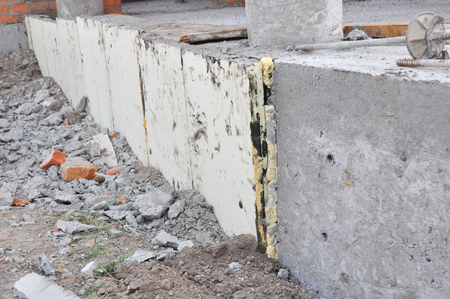 House concrete foundation insulation with stryfoam boards.