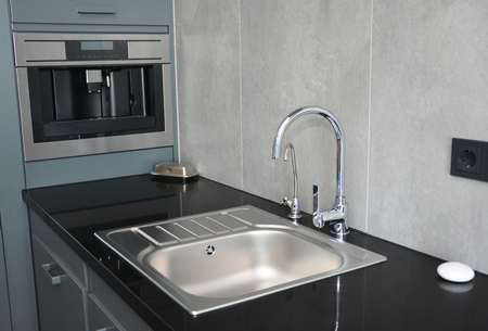 Modern kitchen sink, water tap and chrome faucet for kitchen basin Banco de Imagens