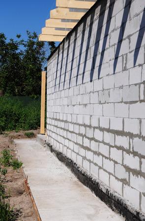 Foundation waterproofing, vapor barrier. Foundation waterproofing construction with concrete path Reklamní fotografie