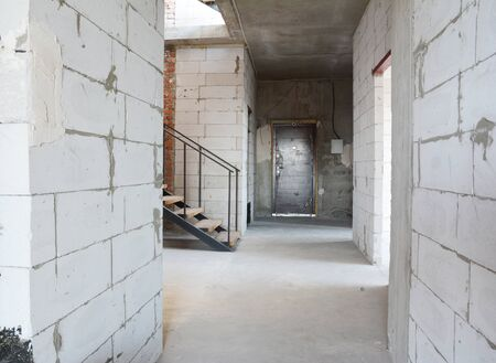 Aerated concrete blocks house corridor walls under construction ready for plastering and stucco