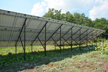 Back side of solar panels plant in the garden Stock Photo