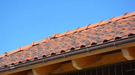 Clay rooftop with rain gutter pipeline