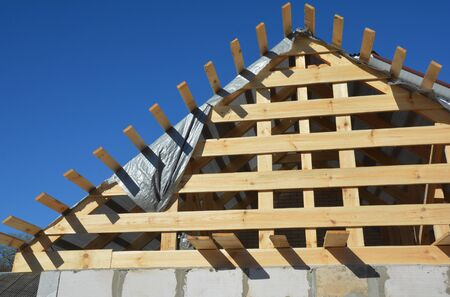 Roofing construction house with wooden beams, trusses, timber - front view. Stock Photo