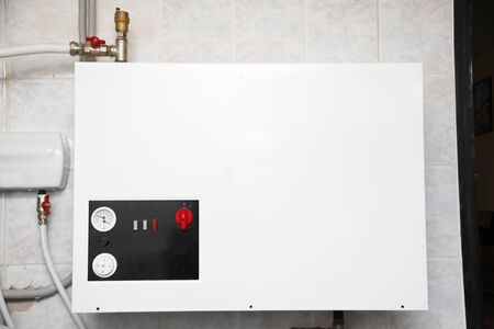 Electric Boiler Board Install. Electric Wet Central Heating System, Electric Water Heating, Boiler. Stock Photo - 126963872