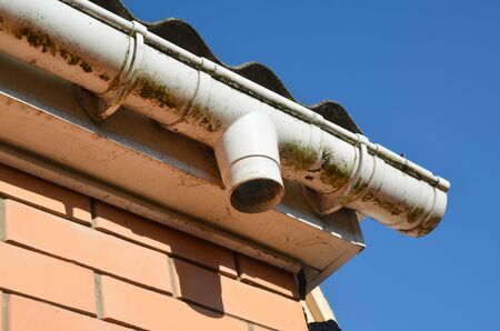 Old plastic roof gutter repair