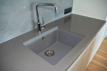 Modern kitchen chrome faucet and  ceramic kitchen sink.
