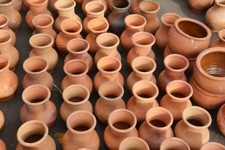 Clay pottery pattern background.  Ceramic craft pots for sale