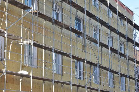 Office building renovation with rock wool insulation. External Wall Insulation with Fiber glass.