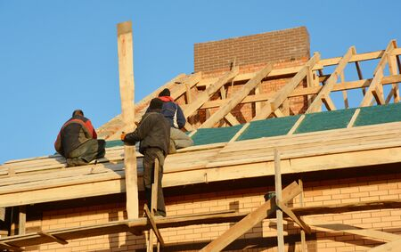 Roofing Contractors Installing House Framework, Roof Board for Asphalt Shingles. Roofing Contractor. Roofing Construction. Roof Repair.