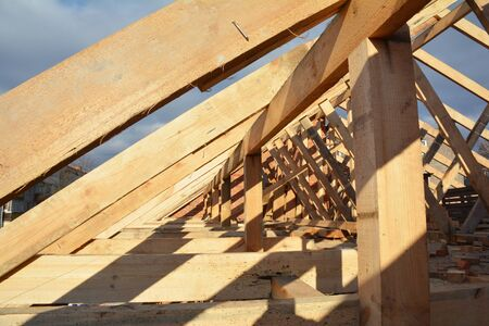 Wooden roof frame house construction view.  House rooftop wooden frame construction.     Stok Fotoğraf