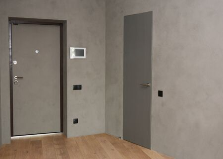 House metal entrance door with mounted  control panel of smart house system