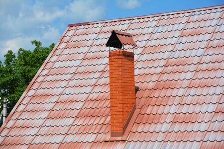 Roof tile of low quality can result in roof discoloration and white stains on slate roof. The red rooftop badly needs to be painted.