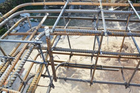 Installation of steel bar reinforcement, footing rebar, welded wire reinforcement in foundation concrete house construction.