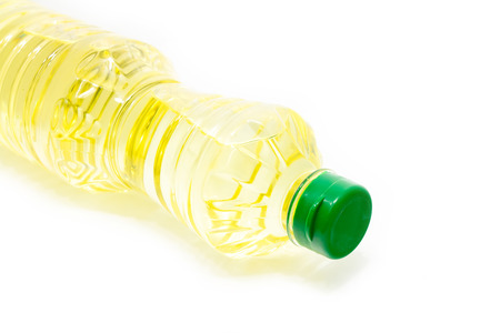 Oil bottle lays down on white background photo