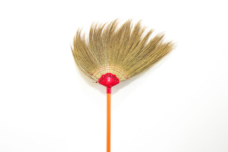 office cleanup: Old broom on white background