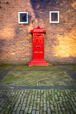 postmaster: Retro Dutch Red Mail Box Stock Photo