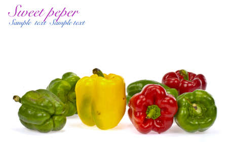 Red green and orange sweet bell peppers isolated on white background photo
