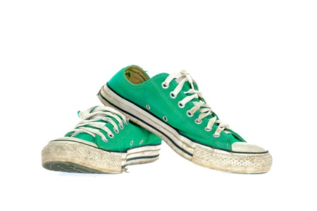 vintage green shoe on White  background photo