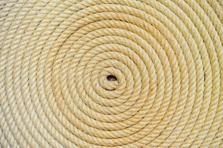 rope knot: background of rope folded helix Stock Photo