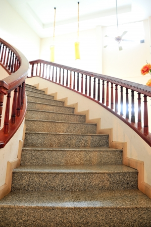 Marble stairs with wooden railing photo