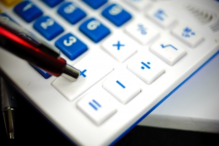 The blue calculator and red pen. Stock Photo
