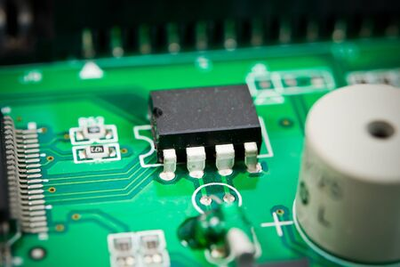 circuit board with electronic components macro background photo