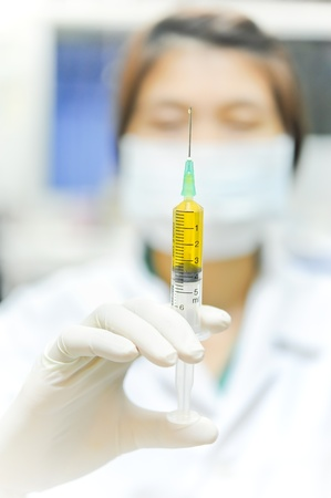 healthcare and medicine  doctor using a syringe photo