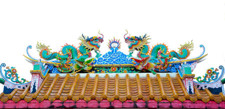 twin dragon statues in Chinese style on top of general temple roof photo