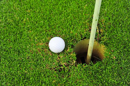 Golf ball and golf hole on the green grass Stock Photo - 16602898