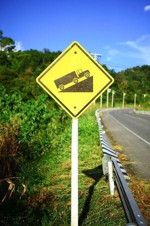 Steep grade hill traffic sign on road in thailand photo