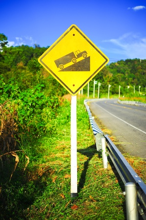 Steep grade hill traffic sign on road in thailand Stock Photo - 16694821