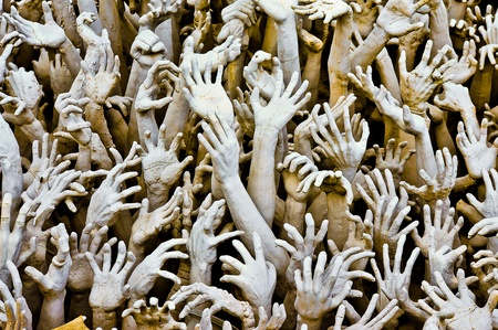 Hands From Hell at Wat Rong Khun in Chiang Rai; Thailand photo