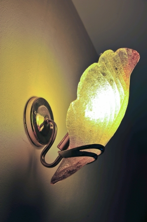 wall sconce: Lighted classic sconce on the wall