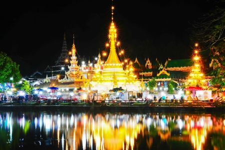 Wat Jong Klang temple reflected in the Nong Jong Kham pond in Mae Hong Son City, Northern Thailand photo