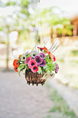 Hanging basket of artificial flowers photo
