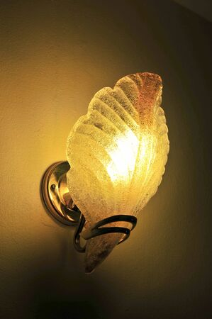 sconce: Lighted classic sconce on the wall