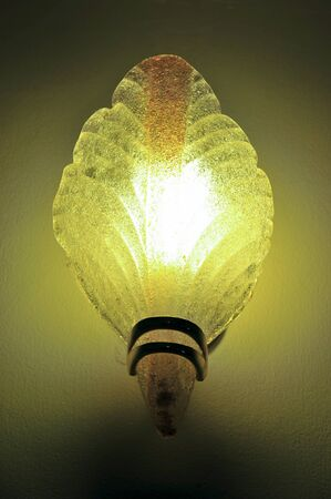 Lighted classic sconce on the wall Stock Photo - 18565218