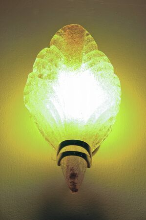 Lighted classic sconce on the wall Stock Photo - 22016965