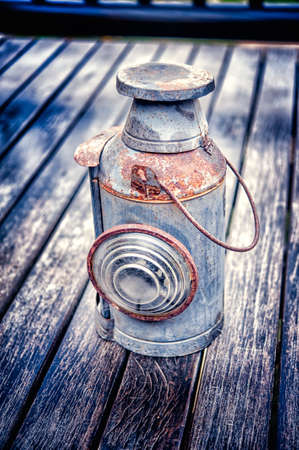 Vintage torch on old wood floor texture photo