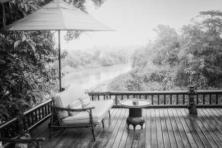 black and white armchairs and river  view on the Terrace photo